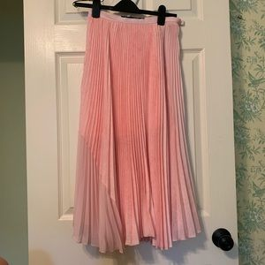 Pink pleated circle skirt